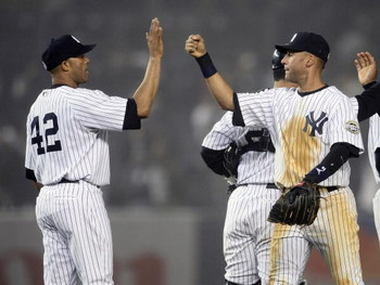 NEW YORK - APRIL 21:  Derek Jeter #2 of the New York Yankees celebrates their win against the Oakland Athletics with teammate Mariano Rivera #42 at Yankee Stadium April 21, 2009 in the Bronx borough of New York City.  (Photo by Nick Laham/Getty Images)