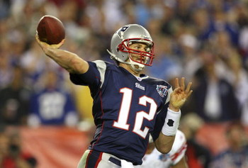 GLENDALE, AZ - FEBRUARY 03:  Quarterback Tom Brady #12 of the New England Patriots drops back to pass against the New York Giants the second half of Super Bowl XLII on February 3, 2008 at the University of Phoenix Stadium in Glendale, Arizona. The Giants