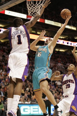 PHOENIX - FEBRUARY 6:  Peja Stojakovic #16 of the New Orleans Hornets shoots over Amare' Stoudemire #1 of the Phoenix Suns on February 6, 2008 at US Airways Center in Phoenix, Arizona. NOTE TO USER: User expressly acknowledges and agrees that, by download