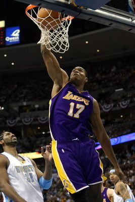 DENVER - MAY 29:  Andrew Bynum #17 of the Los Angeles Lakers dunks the ball in front of Nene #31 of the Denver Nuggets in Game Six of the Western Conference Finals during the 2009 NBA Playoffs at Pepsi Center on May 29, 2009 in Denver, Colorado. NOTE TO U