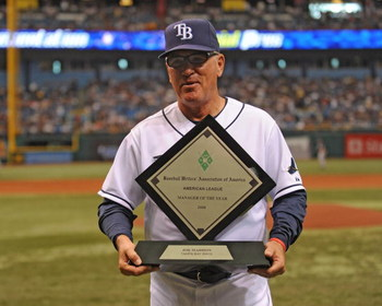 ST. PETERSBURG, FL - APRIL 19: Manager Joe Maddon #70 of the Tampa Bay Rays receives the American League coach of the year award before play against the Chicago White Sox April 19, 2009 at Tropicana Field in St. Petersburg, Florida.  (Photo by Al Messersc