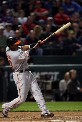 ARLINGTON, TX - APRIL 13:  Adam Jones #10 of the Baltimore Orioles hits a RBI double against the Texas Rangers in the fourth inning on April 13, 2009 at Rangers Ballpark in Arlington, Texas.  (Photo by Ronald Martinez/Getty Images)