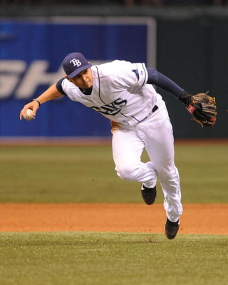 ST. PETERSBURG, FL - APRIL 30: Shortstop Jason Bartlett #8 of the Tampa Bay Rays fields a short infield ball that was the Boston Red Sox only hit April 30, 2009 at Tropicana Field in St. Petersburg, Florida.  (Photo by Al Messerschmidt/Getty Images)