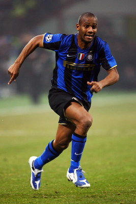 MILAN, ITALY - FEBRUARY 24:  Maicon of Inter Milan runs after the ball during the UEFA Champions League, Round of Last 16, First Leg match between Inter Milan and Manchester United at the San Siro Stadium on February 24, 2009 in Milan, Italy.  (Photo by A