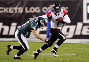 PHILADELPHIA - DECEMBER 31: Michael Vick #7 of the Atlanta Falcons runs the ball against Sean Considine #37 of the Philadelphia Eagles in NFL action December 31, 2006 at Lincoln Financial Field in Philadelphia, Pennsylvania.  (Photo by Jim McIsaac/Getty I