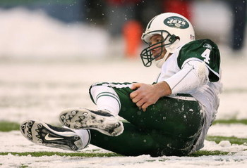 SEATTLE - DECEMBER 21:  Quarterback Brett Favre #4 of the New York Jets gets back up after being tackled by Brandon Mebane of the Seattle Seahawks on the final possession on December 21, 2008 at Qwest Field in Seattle, Washington. The Seahawks defeated th