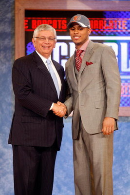 NEW YORK - JUNE 26:  NBA Commissioner David Stern shakes hands with number nine draft pick for the Charlotte Bobcats, D.J. Augustin during the 2008 NBA Draft at the Wamu Theatre at Madison Square Garden June 26, 2008 in New York City. NOTE TO USER: User e