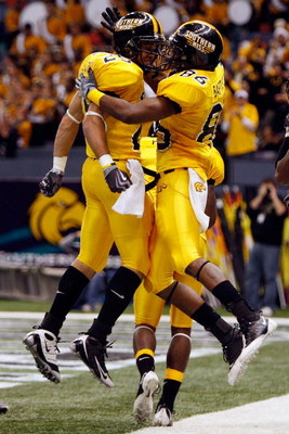 NEW ORLEANS - DECEMBER 21:  Damion Fletcher #25 and Gerald Baptiste #86 of the Southern Mississippi Golden Eagles celebrate after Baptiste scored on a 64 yard pass against the Troy Trojans on during the R+L Carriers New Orleans Bowl on December 21, 2008 a