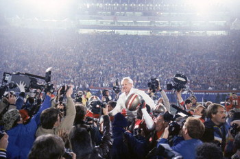 STANFORD, CA - JANUARY 20:  Head coach Bill Walsh of the San Francisco 49ers enjoys a victory ride on the field after defeating the Miami Dolphins 38-16 in Super Bowl XIX at Stanford Stadium on January 20, 1985 in Stanford, California.  (Photo by George R