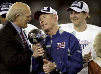 GLENDALE, AZ - FEBRUARY 03:  Head coach TOm Coughlin of the New York Giants holds the Vince Lombardi Trophy as he is interviewed by Terry Bradshaw after his team defeated the New England Patriots 17 0 14 after Super Bowl XLII on February 3, 2008 at the Un