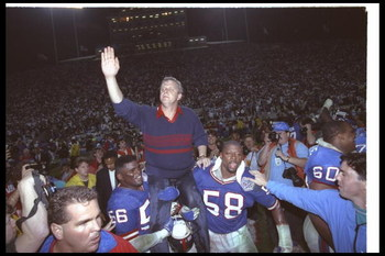 12 Jan 1991: New York Giants head coach Bill Parcells is paraded around on the shoulders of players Lawrence Taylor #56 and Carl Banks #58 after winning Super Bowl XXV against the Buffalo Bills at Tampa Stadium in Tampa, Florida. The Giants won the game,
