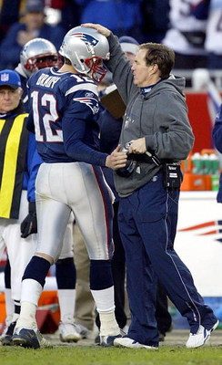 FOXBORO, MA - DECEMBER 27:  Head coach Bill Belichick congratulates quarterback Tom Brady #12 of the New England Patriots after he took Brady out of the game against the Buffalo Bills on December 27, 2003 at Gillette Stadium in Foxboro, Massachusetts. The
