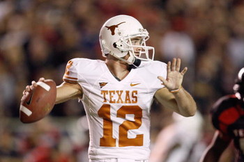 LUBBOCK,TEXAS - NOVEMBER 1:  Quarterback Colt McCoy #12 of the Texas Longhorns looks to pass the ball during the game against the Texas Tech Red Raiders on November 1, 2008 at Jones Stadium in Lubbock, Texas. (Photo by: Jamie Squire/Getty Images)