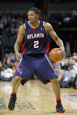 CHARLOTTE, NC - MARCH 6:  Joe Johnson #2 of the Atlanta Hawks dribbles the ball against the Charlotte Bobcats during their game at Time Warner Cable Arena on March 6, 2009 in Charlotte, North Carolina.  NOTE TO USER: User expressly acknowledges and agrees