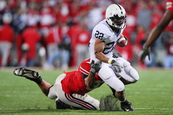 COLUMBUS, OH - OCTOBER 25: Running back Evan Royster #22 of the Penn State Nittany Lions is dragged down by Cameron Heyward #97 of the Ohio State Buckeyes on October 25, 2008 at Ohio Stadium in Columbus, Ohio.  (Photo by Jamie Sabau/Getty Images)