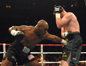 WASHINGTON - JUNE 11:  Mike Tyson connects to the groin area of Kevin McBride during their heavyweight bout at the MCI Center June 11, 2005 in Washington, DC. McBride won by TKO after Mike Tyson's corner stopped the fight at the end of the 6th round.  (Ph