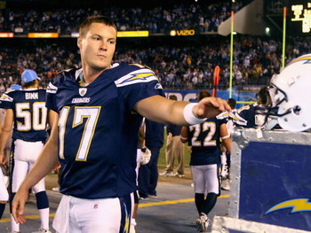 SAN DIEGO - DECEMBER 28:  Quarterback Philip Rivers #17 of the San Diego Chargers reaches for his helmet during the NFL game against the Denver Broncos at Qualcomm Stadium on December 28, 2008 in San Diego, California.  The Chargers defeated the Broncos 5