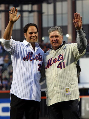 NEW YORK - APRIL 13:  Former Mets players Mike Piazza and Tom Seaver greet fans before throwing out the first pitch of the San Diego Padres against the New York Mets during opening day at Citi Field on April 13, 2009 in the Flushing neighborhood of the Qu