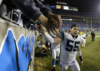 CHARLOTTE, NC - JANUARY 3:  Linebacker Dan Morgan #55 of the Carolina Panthers celebrates after winning the NFC Wildcard game against the Dallas Cowboys at Ericsson Stadium on January 3, 2004 in Charlotte, North Carolina.  The Panthers defeated the Cowboy