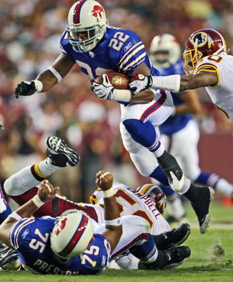LANDOVER, MD - AUGUST 9: Running back Fred Jackson #22 of the Buffalo Bills jumps over a pile during the preseason game against the Washington Redskins on August 9, 2008 at FedEx Field in Landover, Maryland. The Redskins won 17-14. (Photo by Drew Hallowel
