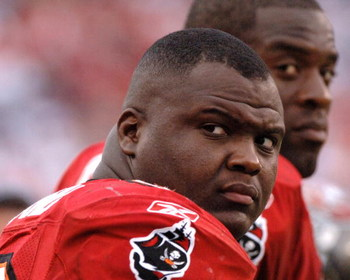Tampa Bay Buccaneers defensive tackle Anthony McFarland watches play  against the Atlanta Falcons  December 24, 2005 in Tampa.  The Bucs defeated the Falcons 27 - 24 in overtime.  (Photo by Al Messerschmidt/Getty Images)