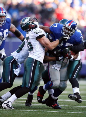 EAST RUTHERFORD, NJ - JANUARY 11:  Brandon Jacobs #27 of the New York Giants runs against Stewart Bradley #55 of the Philadelphia Eagles during the NFC Divisional Playoff Game on January 11, 2009 at Giants Stadium in East Rutherford, New Jersey.  (Photo b