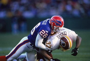 7 Nov 1999:  Antoine Winfield #26 of the Buffalo Bills tackles Larry Centers #37 of the Washington Redskins during the game at the Redskins Stadium in Landover, Maryland. The Bills defeated the Redskins 34-17. Mandatory Credit: Doug Pensinger  /Allsport