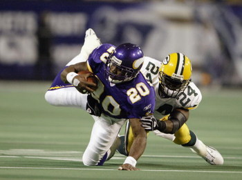 MINNEAPOLIS - NOVEMBER 2:  Running back Moe Williams #20 of the Minnesota Vikings is tackled by safety Antuan Edwards #24 of the Green Bay Packers during the game at the Hubert H. Humphrey Metrodome on November 2, 2003 in Minneapolis, Minnesota. The Green