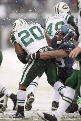 SEATTLE - DECEMBER 21:  Thomas Jones #20 of the New York Jets is tackled by Darryl Tapp #55 of the Seattle Seahawks on December 21, 2008 at Qwest Field in Seattle, Washington. The Seahawks defeated the Jets 13-3. (Photo by Otto Greule Jr/Getty Images)