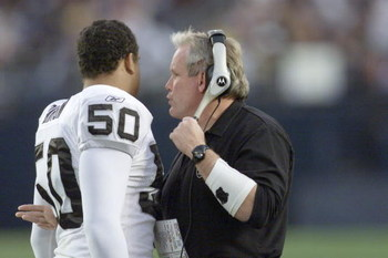 15 Dec 2001:   Chuck Bresnahan defensive coordinator for the Oakland Raiders talks with linebacker Eric Barton #50  during their game at Qualcomm Stadium in San Diego, California.  The Raiders won 13-6. DIGITAL IMAGE   Mandatory Credit:  Stephen Dunn/ALLS