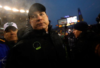 FOXBORO, MA - DECEMBER 16:  Coach Eric Mangini of the New York Jets leaves the field after shaking the hand of coach Bill Belichick at Gillette Stadium on December 16, 2007 in Foxboro, Massachusetts. The Patriots won 20-10. (Photo by Jim Rogash/Getty Imag