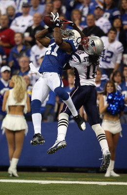 INDIANAPOLIS - NOVEMBER 04:  Antoine Bethea #41 of the Indianapolis Colts intercepts a pass in the second quarter against Donte Stallworth #18 of the New England Patriots on November 4, 2007 at the RCA Dome in Indianapolis, Indiana.  (Photo by Andy Lyons/