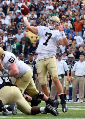 BALTIMORE - NOVEMBER 15:  Jimmy Clausen #7 of the Notre Dame Fighting Irish throws a pass against the Navy Midshipmen on November 15, 2008 at M&amp;T Bank Stadium in Baltimore, Maryland. Notre Dame defeated Navy 27-21.  (Photo by Jim McIsaac/Getty Images)