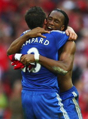 LONDON - APRIL 18: Didier Drogba and Frank Lampard of Chelsea celebrate victory after the FA Cup sponsored by E.ON Semi Final match between Arsenal and Chelsea at Wembley Stadium on April 18, 2009 in London, England.  (Photo by Jamie McDonald/Getty Images