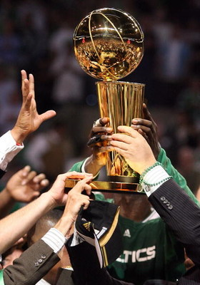 BOSTON - JUNE 17:  The Boston Celtics celebrate with the Larry O'Brien Trophy after defeating the Los Angeles Lakers in Game Five of the 2008 NBA Finals on June 17, 2008 at TD Banknorth Garden in Boston, Massachusetts. NOTE TO USER: User expressly acknowl