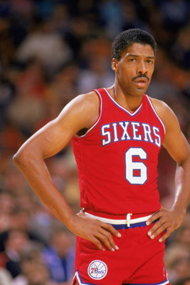 LOS ANGELES - 1987:  Julius Erving #6 of the Philadelphia 76ers rests during the 1987 game against the Los Angeles Lakers at the Great Western Forum in Los Angeles, California.  (Photo by Stephen Dunn/Getty Images)