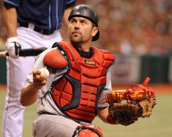 ST. PETERSBURG, FL - MAY 3: Catcher Jason Varitek #33 of the Boston Red Sox looks for a new ball against the Tampa Bay Rays May 3, 2009 at Tropicana Field in St. Petersburg, Florida. (Photo by Al Messerschmidt/Getty Images)