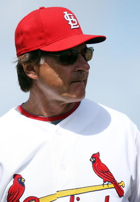JUPITER, FL - FEBRUARY 25:  Manager Tony La Russa #10 of the St. Louis Cardinals watches his pitcher warm up before taking on the Florida Marlins during a spring training game at Roger Dean Stadium February 25, 2009 in Jupiter, Florida.  (Photo by Doug Be