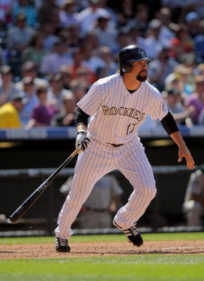 DENVER - APRIL 29:  First baseman Todd Helton #17 of the Colorado Rockies takes an at bat against the San Diego Padres during MLB action at Coors Field on April 29, 2009 in Denver, Colorado. The Rockies defeated the Padres 7-5.  (Photo by Doug Pensinger/G