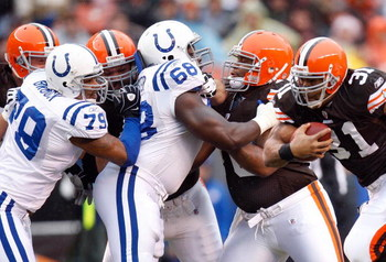 CLEVELAND - NOVEMBER 30:  Jamal Lewis #31 of the Cleveland Browns runs witht he ball against Raheem Brock #79 and Eric Foster #68 of the Indianapolis Colts during their NFL game on November 30, 2008 at Cleveland Browns Stadium in Cleveland, Ohio. The Colt