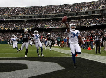 OAKLAND, CA - DECEMBER 16:  Kick returner T.J. Rushing #34 of the Indianapolis Colts celebrates as he scores on a punt return against the Oakland Raiders at McAfee Coliseum December 16, 2007 in Oakland, California. The Colts won 21-14.  (Photo by Stephen