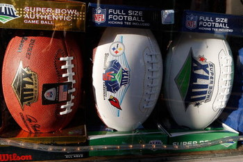 TAMPA, FL - JANUARY 30:  Footballs with Super Bowl XLIII logos sit in a window at a store on January 30, 2009 in Tampa, Florida. NFL Fans from across the country are descending on Tampa ahead of Super Bowl XLIII between the Arizona Cardinals and the Pitts