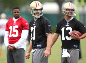 SANTA CLARA, CA - MAY 01:  Michael Crabtree #15 of the San Francisco 49ers looks on during practice as quaterback Alex Smith #11 and Shaun Hill #13 practice during the 49ers Minicamp at their training facilities on May 1, 2009 in Santa Clara, California.