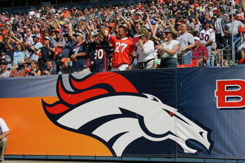 DENVER - SEPTEMBER 26:  Fans cheer on as the Denver Broncos host the San Diego Chargers on September 26, 2004 at Invesco Field in Denver, Colorado. The Broncos defeated the Chargers 23-13.  (Photo by Ronald Martinez/Getty Images)