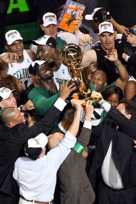 BOSTON - JUNE 17:  Kevin Garnett #5 of the Boston Celtics celebrates with the Larry O'Brien trophy after defeating the Los Angeles Lakers in Game Six of the 2008 NBA Finals on June 17, 2008 at TD Banknorth Garden in Boston, Massachusetts. NOTE TO USER: Us