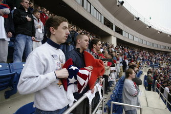 PHILADELPHIA - APRIL 4:  Fans stand at attention during the national anthem before the home opener between the Philadelphia Phillies and the Pittsburgh Pirates at Veterans Stadium on April 4, 2003 in Philadelphia, Pennsylvania.  The Pirates defeated the P