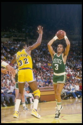 Oct 1989:  Guard Dennis Johnson of the Boston Celtics looks to pass the ball during a game against the Los Angeles Lakers at the Great Western Forum in Inglewood, California. Mandatory Credit: Rick Stewart  /Allsport