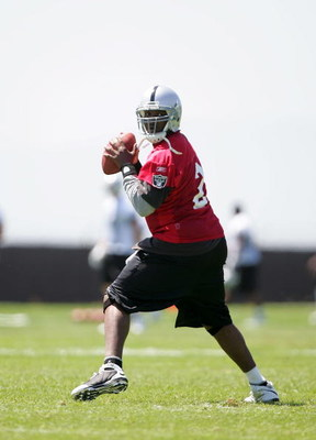ALAMEDA, CA - MAY 08:  JaMarcus Russell #2 of the Oakland Raiders drops back to pass the ball during the Raiders minicamp at the team's permanent training facility on May 8, 2009 in Alameda, California.  (Photo by Ezra Shaw/Getty Images)
