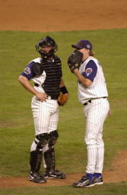 4 Nov 2001: Curt Schilling #38 and Damian Miller #26 of the Arizona Diamondbacks confer on the mounds during game seven of the Major League Baseball World Series at Bank One Ballpark in Phoenix, Arizona. The Diamondbacks won 3-2 to capture the World Serie