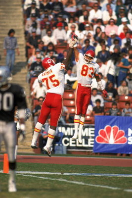 LOS ANGELES - 1986:  Wide receiver Stephone Paige #83 and Irv Eatman #75 of the Kansas City Chiefs celebrate with a high five during a 1986 NFL game against the Los Angeles Raiders at the LA Memorial Coliseum in Los Angeles, California.  The Raiders defea